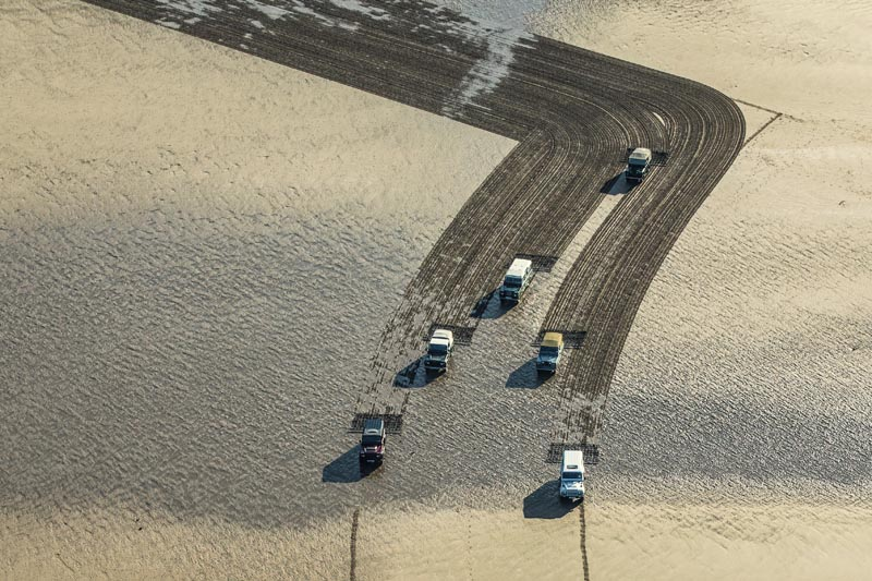 Land Rover Defender drawing in the sand